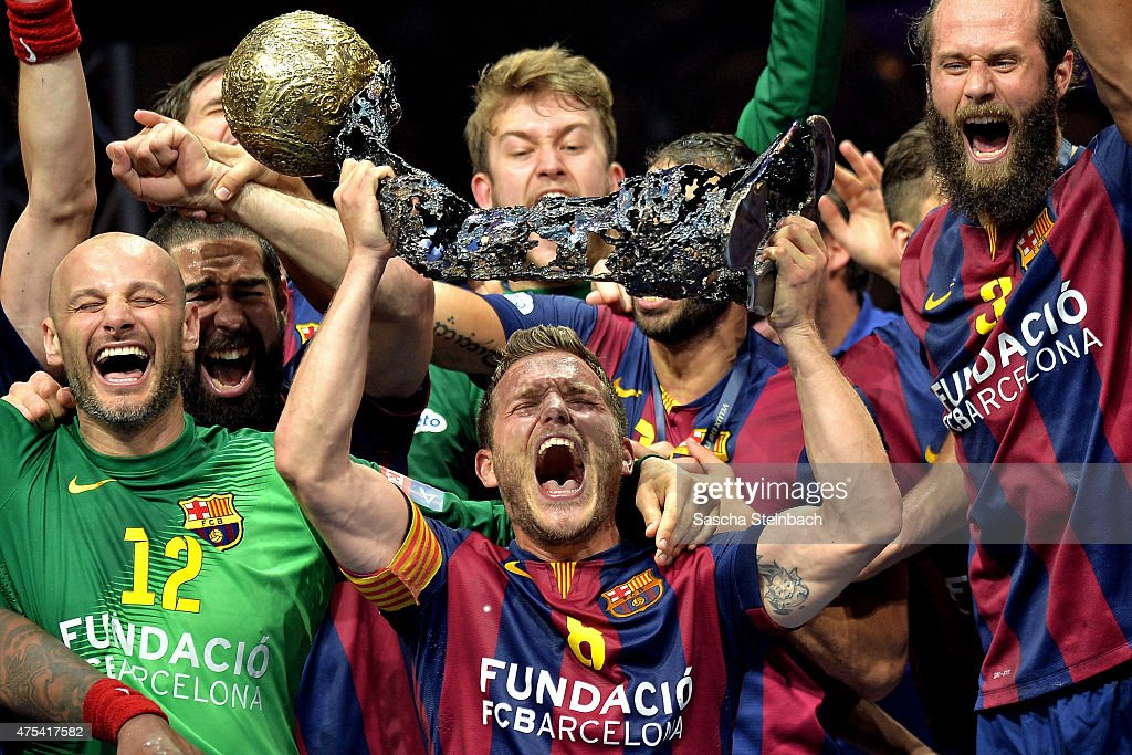 <a gi-track='captionPersonalityLinkClicked' href=/galleries/search?phrase=Victor+Tomas&family=editorial&specificpeople=3260334 ng-click='$event.stopPropagation()'>Victor Tomas</a> Gonzalez (C) of Barcelona receives the trophy after winning the 'VELUX EHF FINAL4' final match against MKB-MVM Veszprem at Lanxess Arena on May 31, 2015 in Cologne, Germany.