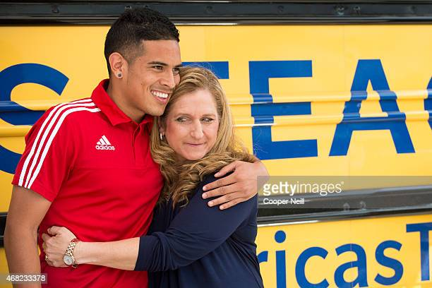 Victor Ulloa of FC Dallas hugs his former teacher Deanna Toler as part of Farmers Insurance's 'Thank America's Teachers' program at Francisco...