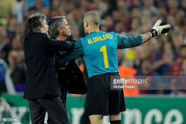 Victor Valdes of Barcelona grapples with Jose Mourinho of Inter Milan after the UEFA Champions League Semi Final Second Leg match between Barcelona...