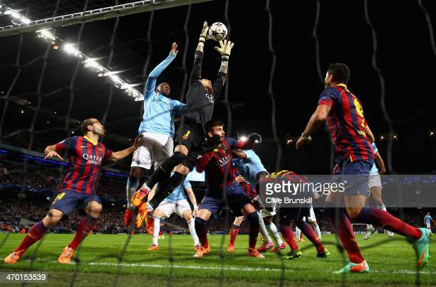 Victor Valdes of Barcelona rises to make a save under pressure during the UEFA Champions League Round of 16 first leg match between Manchester City...