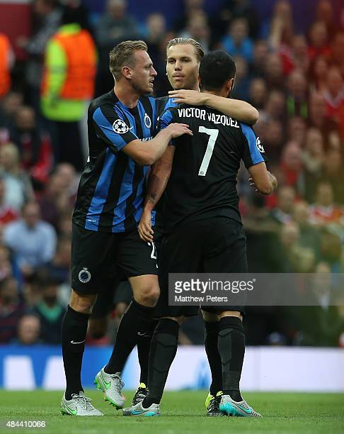 Victor Valdes of Club Brugge celebrates Michael Carrick of Manchester United scoring an owngoal during the UEFA Champions League playoff first leg...