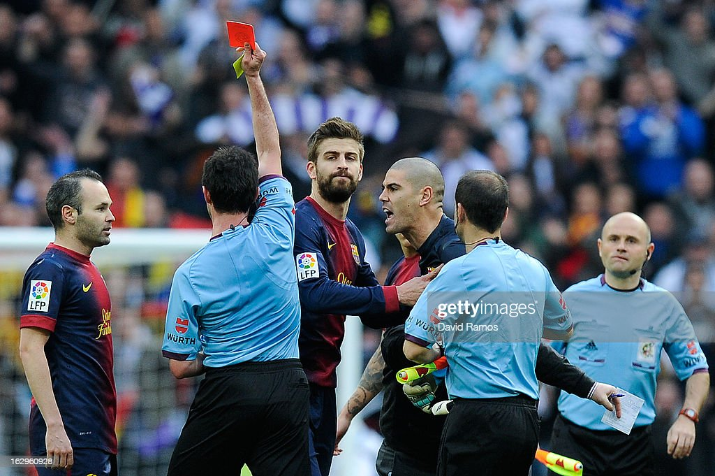Victor Valdes of FC Barcelona is shown a red card by the referee Perez Lasa during the La Liga match between Real Madrid CF and FC Barcelona at Bernabeu on March 2, 2013 in Madrid, Spain.