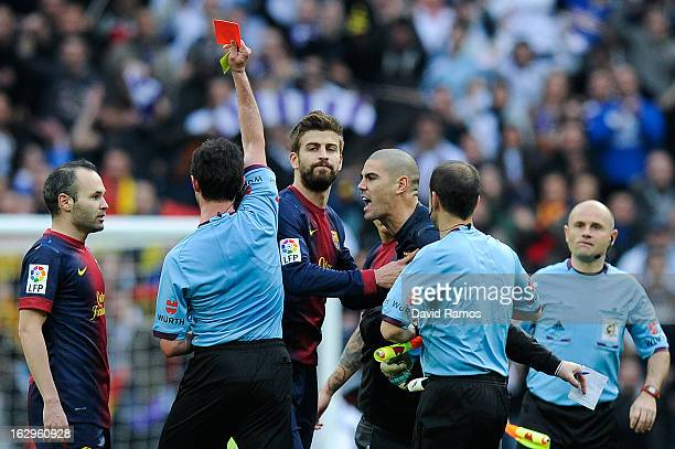 Victor Valdes of FC Barcelona is shown a red card by the referee Perez Lasa during the La Liga match between Real Madrid CF and FC Barcelona at...