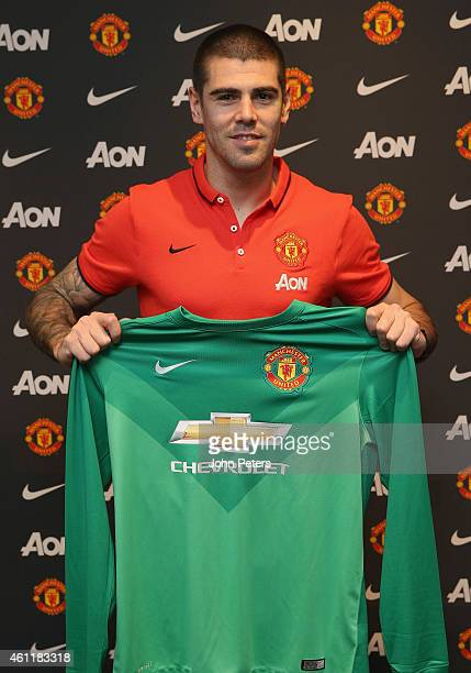 Victor Valdes of Manchester United poses after signing for the club at Aon Training Complex on January 8 2015 in Manchester England