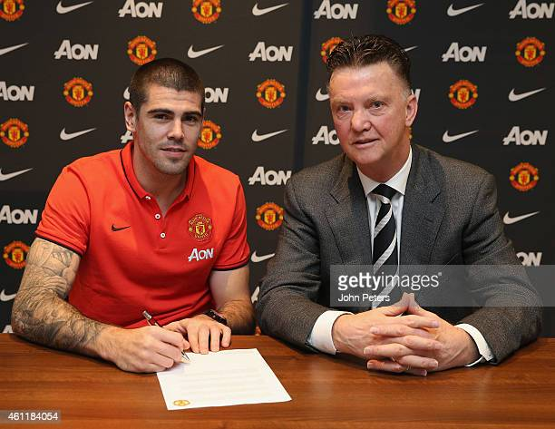 Victor Valdes of Manchester United poses with Manager Louis van Gaal after signing for the club at Aon Training Complex on January 8 2015 in...