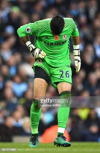 Victor Valdes of Middlesbrough looks at his leg after a challenge from Jesus Navas of Manchester City during the Premier League match between...