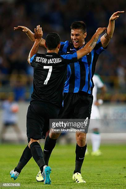 Victor Vazquez of Club Brugge celebrates scoring his teams second goal of the game with team mate Oscar Duarte during the third qualifying round 2nd...