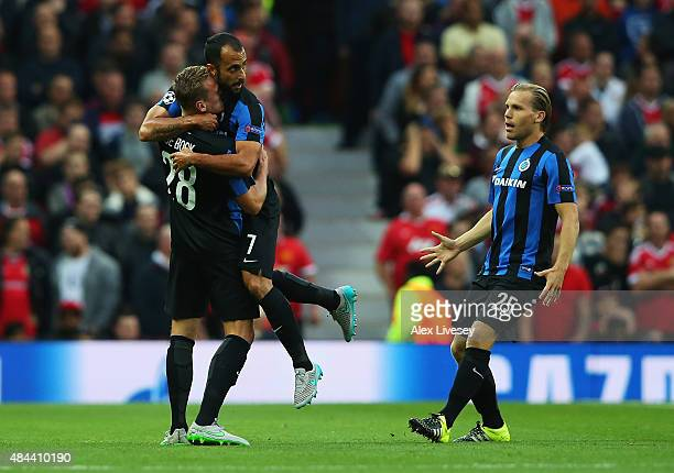 Victor Vazquez of Club Brugge celebrates the own goal scored by Michael Carrick of Manchester United with Laurens De Bock and Ruud Vormer during the...