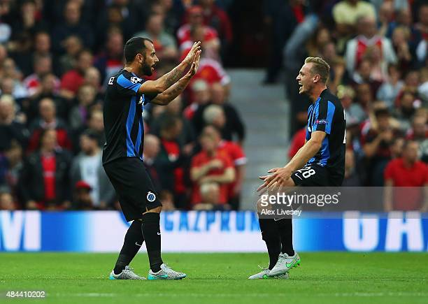 Victor Vazquez of Club Brugge celebrates the own goal scored by Michael Carrick of Manchester United with Laurens De Bock of Club Brugge during the...
