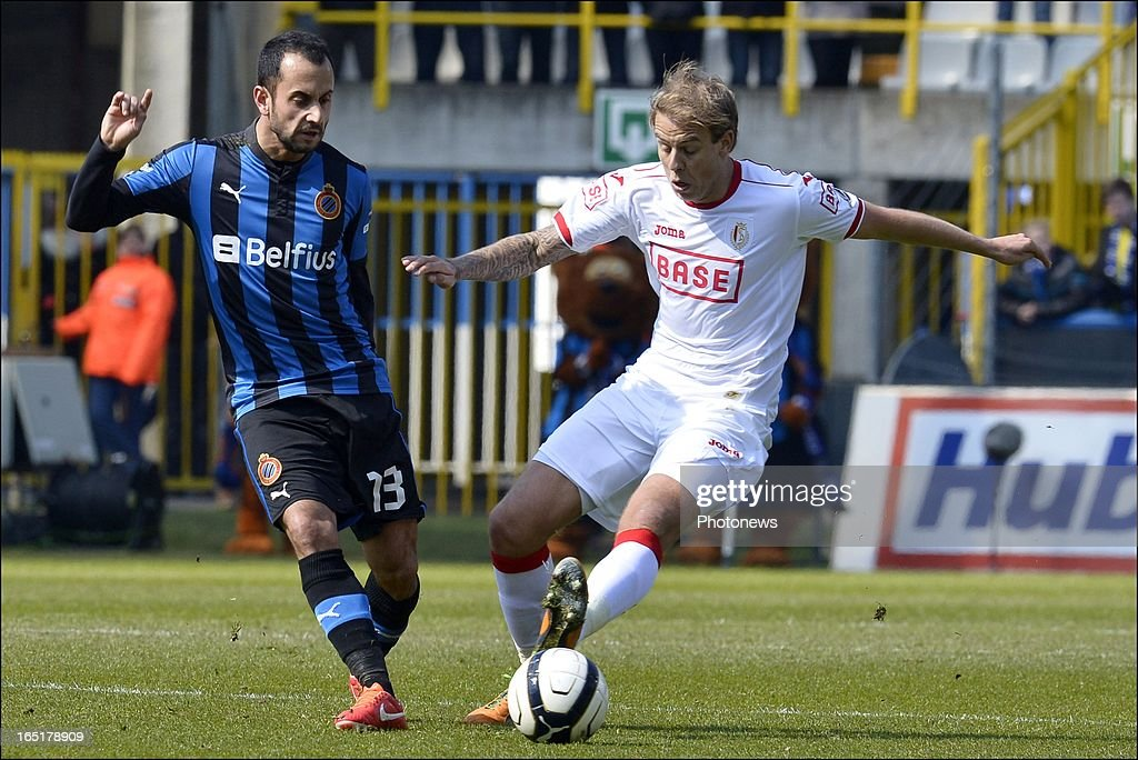 Victor Vazquez of Club Brugge KV battles for the ball with Yoni Buyens of Standard during the Jupiler League match between Club Brugge and Standard de Liege , in the Jan Breydel Stadium on April 01, 2013 in Brugge, Belgium.