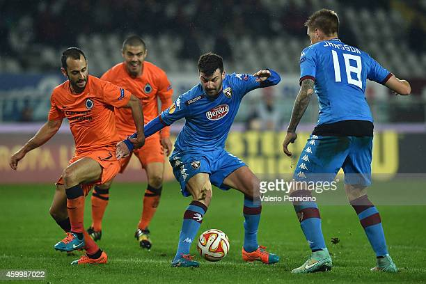 Victor Vazquez of Club Brugge KV competes with Cesare Bovo of Torino FC during the UEFA Europa League group B match between Torino FC and Club Brugge...