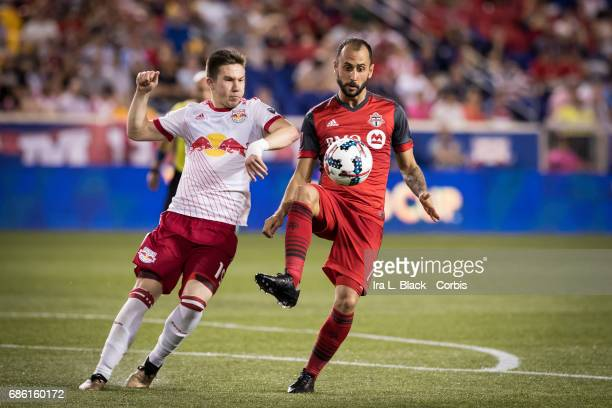 Victor Vazquez of Toronto FC keeps the ball in front of himself and away from Alex Muyl of NY Red Bulls for during theToronto FC vs New York Red...