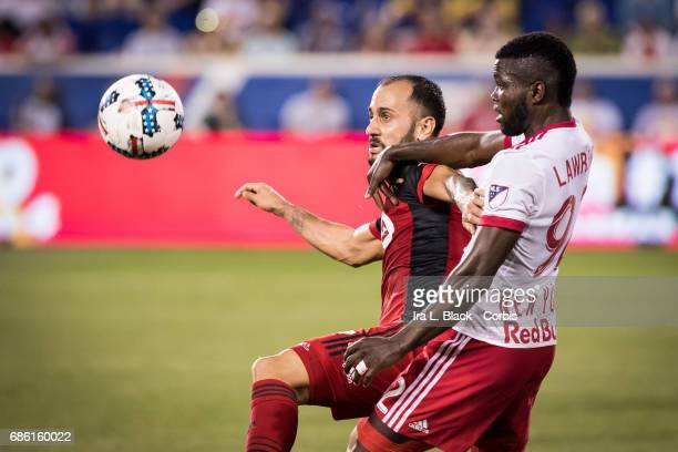 Victor Vazquez of Toronto FC tried to block out Kemar Lawrence of NY Red Bulls for control of the ball during theToronto FC vs New York Red Bulls MLS...