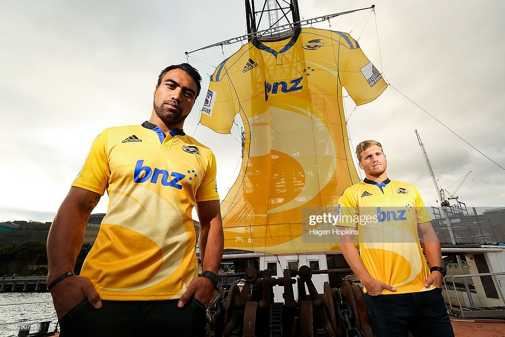 Victor Vito and Brad Shields of the Hurricanes pose in front of a giant adidas Super Rugby replica jersey to mark the launch of the replica jerseys...