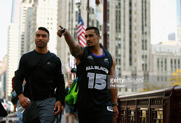 Victor Vito and Jerome Kaino of the New Zealand All Blacks take in a bit of sightseeing as they walk along Michigan Ave following a pool recovery...