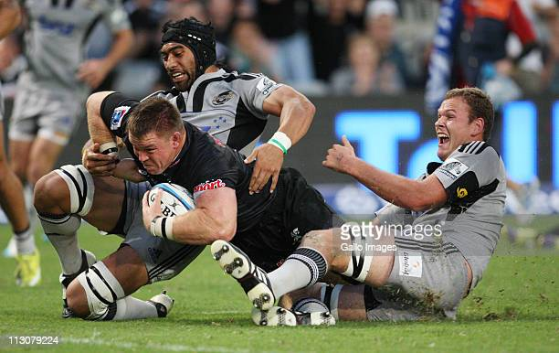 Victor Vito in action with John Smit during the Vodacom Super Rugby match between Sharks and Hurricanes from Mr Price Kings Park Stadium on April 23...