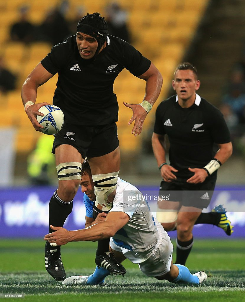 Victor Vito of the All Blacks is tackled during The Rugby Championship match between the New Zealand All Blacks and Argentina at Westpac Stadium on...