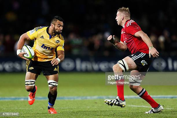 Victor Vito of the Hurricanes is challenged by Luke Romano of the Crusaders during the round 16 Super Rugby match between the Crusaders and the...