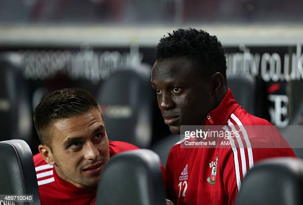 Victor Wanyama and Dusan Tadic of Southampton on the bench before the Capital One Cup third round match between MK Dons and Southampton at Stadium mk...