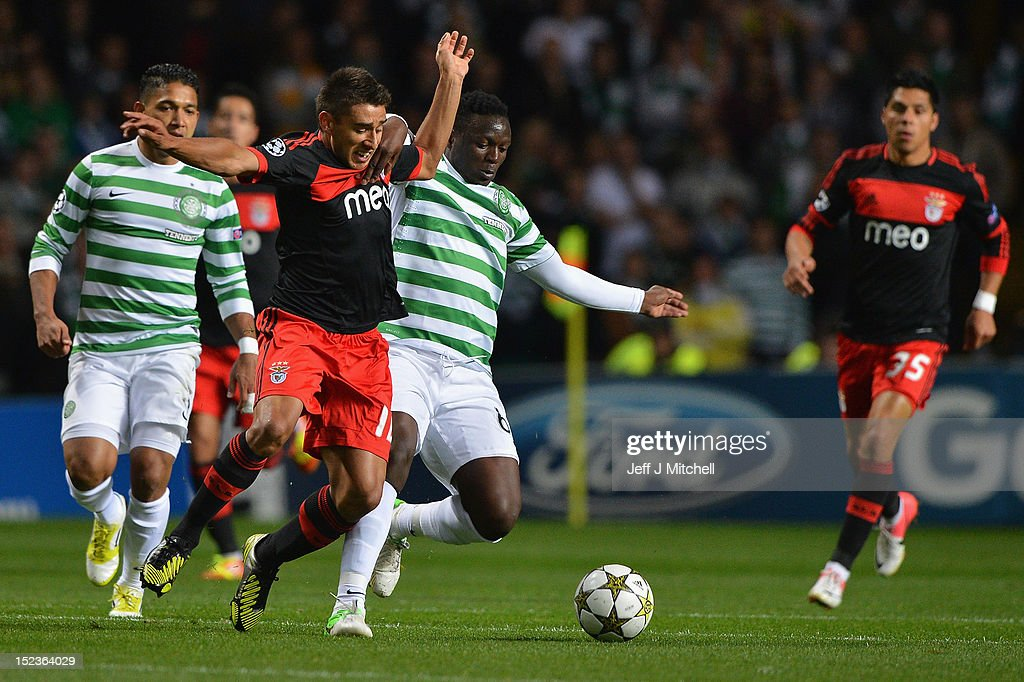 Victor Wanyama of Celtic tackles Eduardo Salvio of SL Benfica during the UEFA Champions League Group G match between Celtic and SL Benfica at Celtic Park on September 19, 2012 in Glasgow,Scotland.