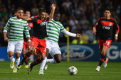 Victor Wanyama of Celtic tackles Eduardo Salvio of SL Benfica during the UEFA Champions League Group G match between Celtic and SL Benfica at Celtic...