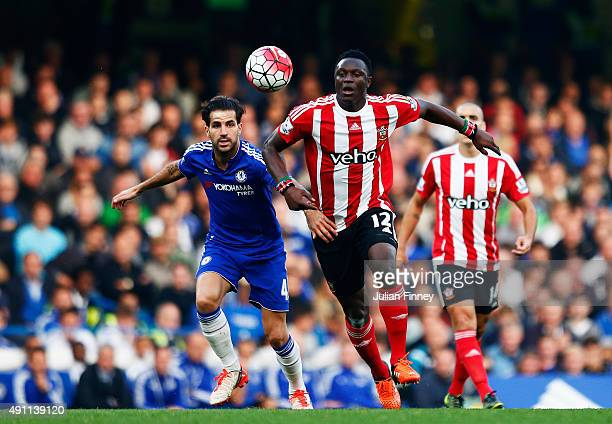 Victor Wanyama of Southampton and Cesc Fabregas of Chelsea compete for the ball during the Barclays Premier League match between Chelsea and...