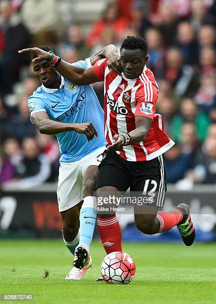 Victor Wanyama of Southampton and Kelechi Iheanacho of Manchester City tussle for the ball during the Barclays Premier League match between...