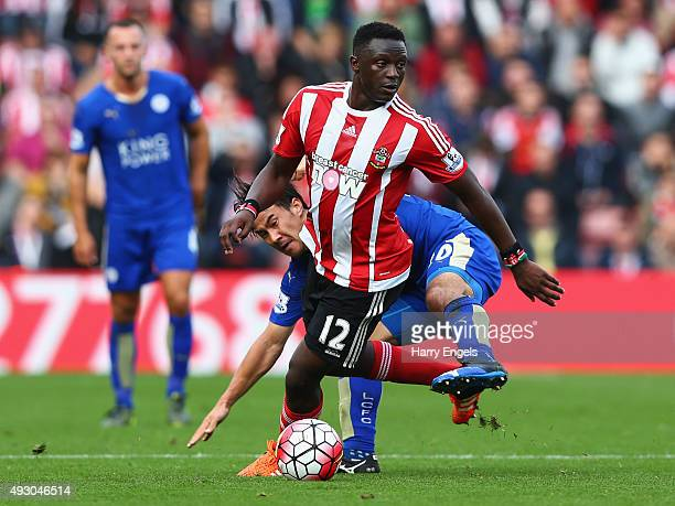 Victor Wanyama of Southampton and Shinji Okazaki of Leicester City compete for the ball during the Barclays Premier League match between Southampton...