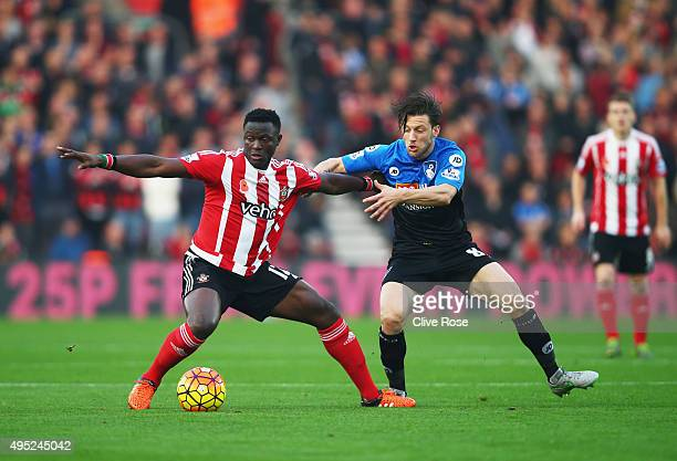 Victor Wanyama of Southampton holds off Harry Arter of Bournemouth during the Barclays Premier League match between Southampton and AFC Bournemouth...