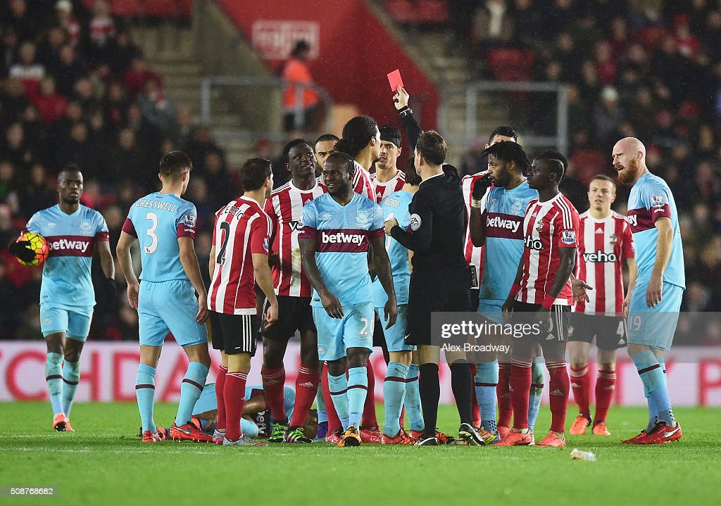 Victor Wanyama of Southampton (4L) is shown a red card and is sent off by referee Mark Clattenburg during the Barclays Premier League match between Southampton and West Ham United at St Mary's Stadium on February 6, 2016 in Southampton, England.
