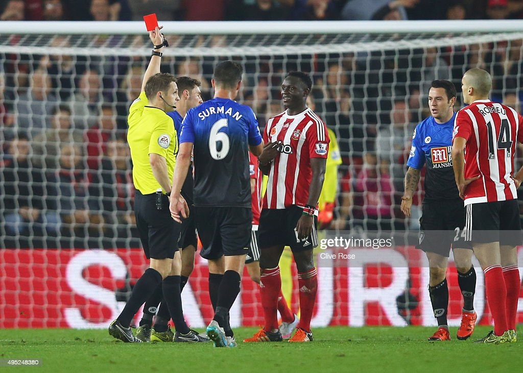 Victor Wanyama of Southampton is shown a red card by referee Craig Pawson and is sent off during the Barclays Premier League match between...