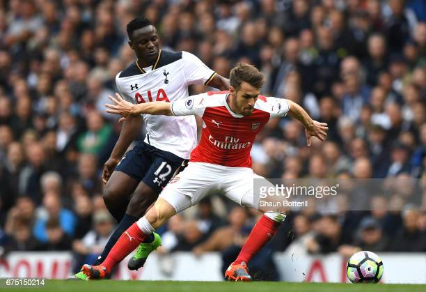 Victor Wanyama of Tottenham Hotspur and Aaron Ramsey of Arsenal battle for possession during the Premier League match between Tottenham Hotspur and...