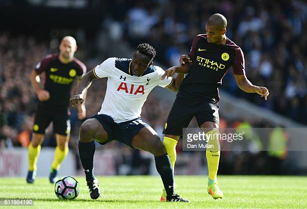 Victor Wanyama of Tottenham Hotspur and Fernandinho of Manchester City battle for possession during the Premier League match between Tottenham...