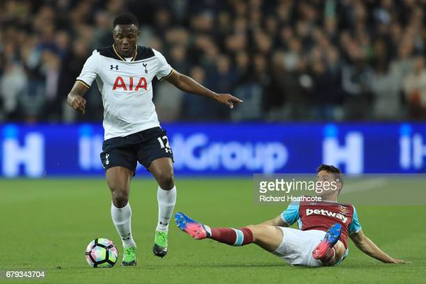 Victor Wanyama of Tottenham Hotspur goes past the challenge from Jonathan Calleri of West Ham United during the Premier League match between West Ham...