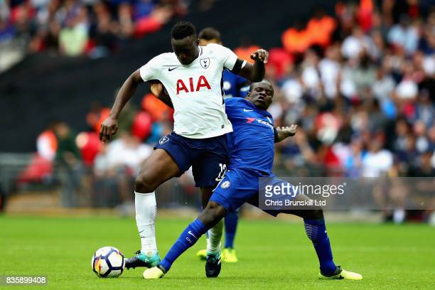 Victor Wanyama of Tottenham Hotspur is challenged by N'Golo Kante of Chelsea during the Premier League match between Tottenham Hotspur and Chelsea at...