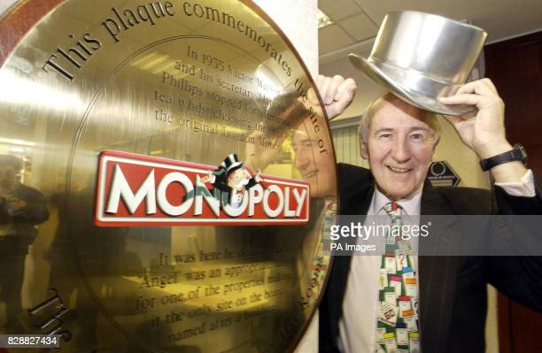 Victor Watson the grandson of the original Victor who devised the street names for the famous Monopoly board unveils a plaque at the Cooperative Bank...