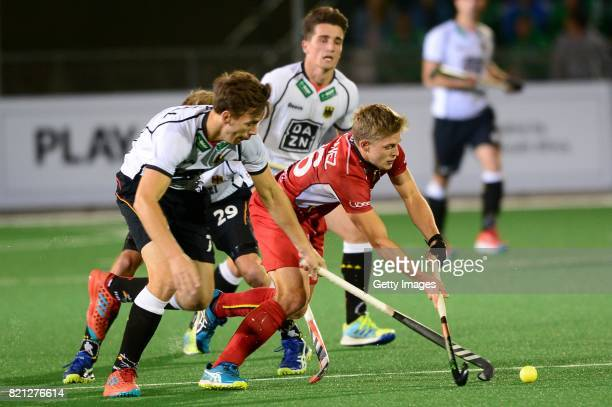 Victor Wegnez of Belgium tackled by Jonas Gomoll of Germany during day 9 of the FIH Hockey World League Men's Semi Finals final match between Belgium...