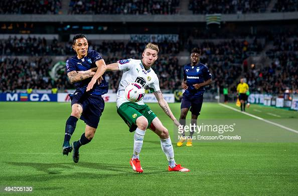 Victor Yoshimar Yotun Flores of Malmo FF and Birkir Már Savarsson of Hammarby IF in action during the Allsvenskan match between Hammarby IF and...