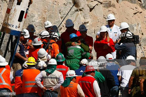 Victor Zamora is embraced by his wife at his arrival to the surface during the rescue operation of 33 miners trapped 700 meters underground for two...