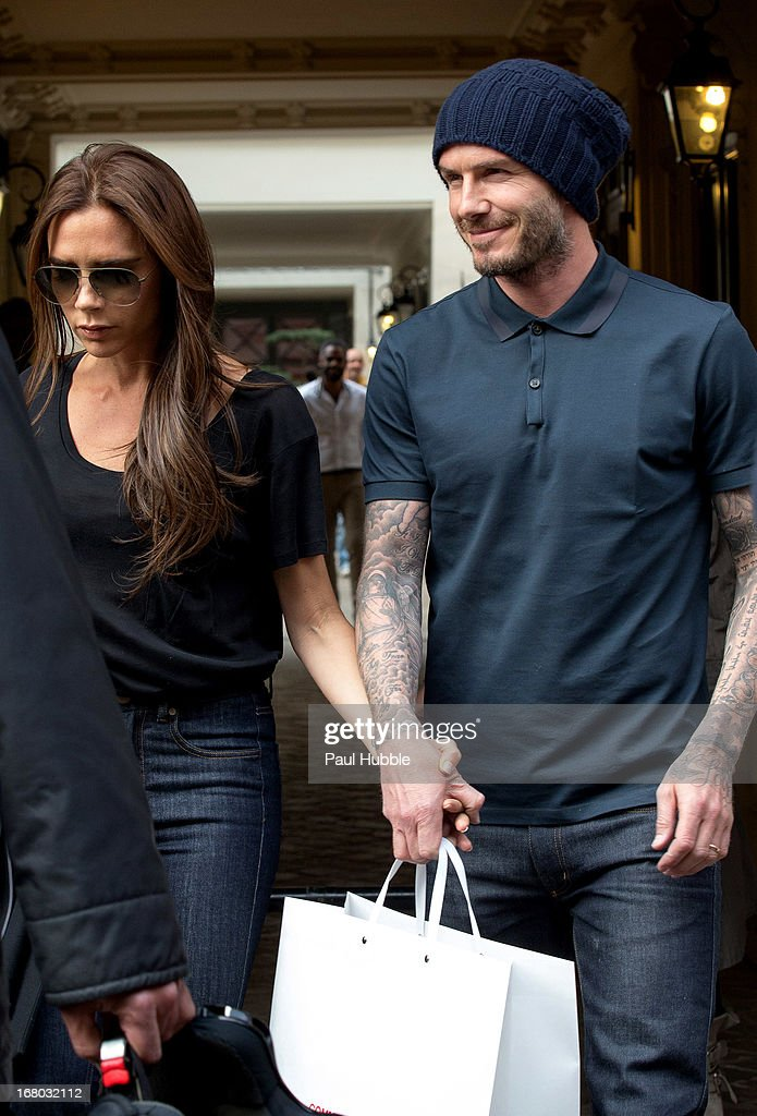 Victoria and <a gi-track='captionPersonalityLinkClicked' href=/galleries/search?phrase=David+Beckham&family=editorial&specificpeople=158480 ng-click='$event.stopPropagation()'>David Beckham</a> are seen leaving the 'Comme des garcons' store on May 4, 2013 in Paris, France.