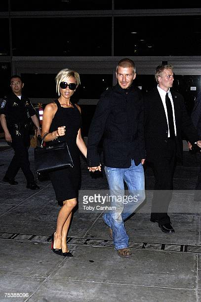 Victoria and David Beckham arrive at Los Angeles International Airport July 12 2007 in Los Angeles California