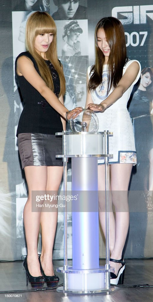 Victoria and Krystal of South Korean girl group f(x) attend during the 'S.M.ART Exhibition' opening ceremony held at Coex on August 09, 2012 in Seoul, South Korea.