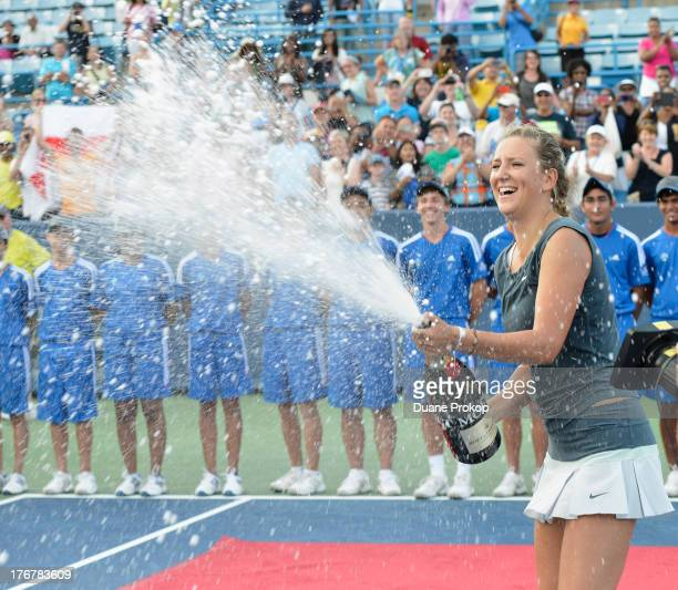 Victoria Azarenka celebrates her victory over Serena Williams with Moet Chandon at Lindner Family Tennis Center on August 18 2013 in Mason Ohio