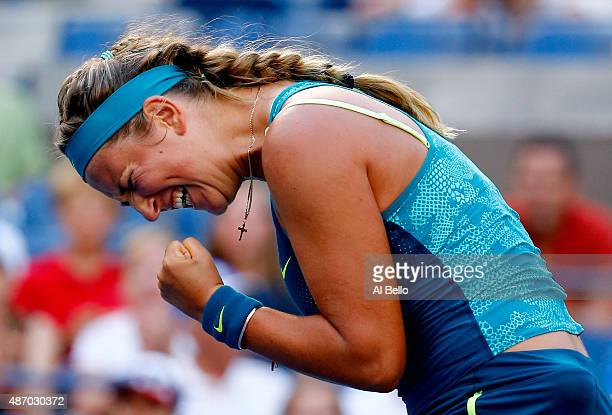 Victoria Azarenka of Belarus celebrates a point to win the first set against Angelique Kerber of Germany during their Women's Singles Third Round...