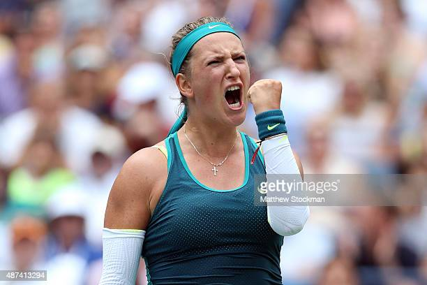 Victoria Azarenka of Belarus celebrates after winning the second set against Simona Halep of Romania during their Women's Singles Quarterfinals match...