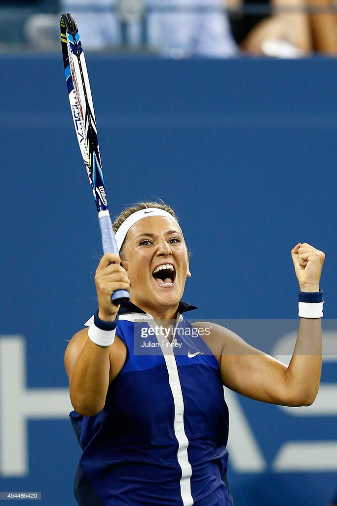 <a gi-track='captionPersonalityLinkClicked' href=/galleries/search?phrase=Victoria+Azarenka&family=editorial&specificpeople=604872 ng-click='$event.stopPropagation()'>Victoria Azarenka</a> of Belarus celebrates defeating Aleksandra Krunic of Serbia during their women's singles fourth round match on Day Eight of the 2014 US Open at the USTA Billie Jean King National Tennis Center on September 1, 2014 in the Flushing neighborhood of the Queens borough of New York City.