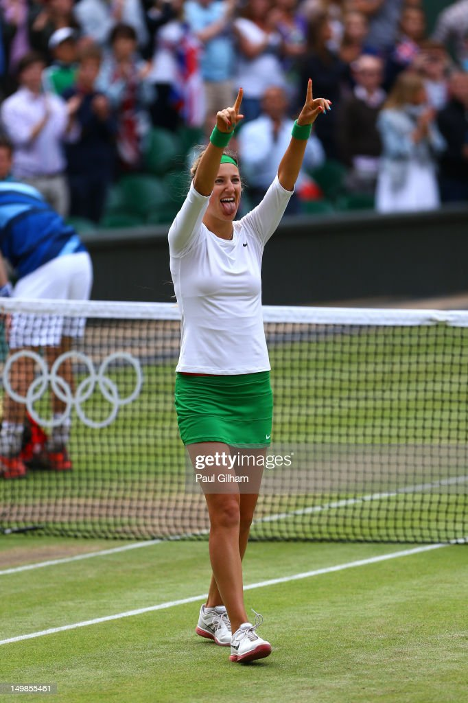<a gi-track='captionPersonalityLinkClicked' href=/galleries/search?phrase=Victoria+Azarenka&family=editorial&specificpeople=604872 ng-click='$event.stopPropagation()'>Victoria Azarenka</a> of Belarus celebrates winning gold with her partner Max Mirnyi of Belarus after their Mixed Doubles Tennis gold medal match against Laura Robson of Great Britain and Andy Murray of Great Britain on Day 9 of the London 2012 Olympic Games at the All England Lawn Tennis and Croquet Club on August 5, 2012 in London, England.