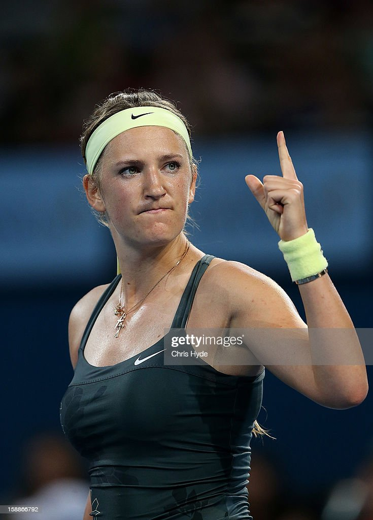 Victoria Azarenka of Belarus celebrates winning her game against Sabine Lisicki of Germany on day four of the Brisbane International at Pat Rafter Arena on January 2, 2013 in Brisbane, Australia.