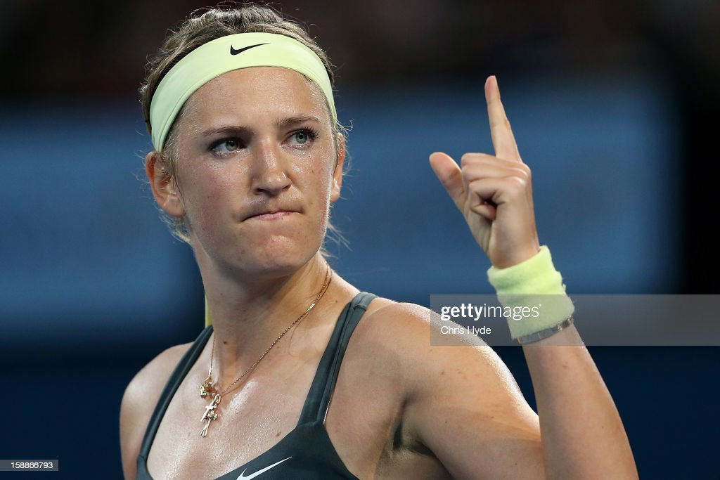 <a gi-track='captionPersonalityLinkClicked' href=/galleries/search?phrase=Victoria+Azarenka&family=editorial&specificpeople=604872 ng-click='$event.stopPropagation()'>Victoria Azarenka</a> of Belarus celebrates winning her game against Sabine Lisicki of Germany on day four of the Brisbane International at Pat Rafter Arena on January 2, 2013 in Brisbane, Australia.