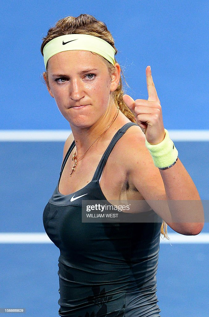 Victoria Azarenka of Belarus celebrates winning her match against Sabine Lisicki of Germany in the second round at the Brisbane International tennis tournament on January 2, 2013. AFP PHOTO/William WEST USE